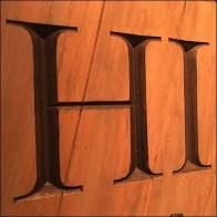 Carved vs Engraved Wood Signage