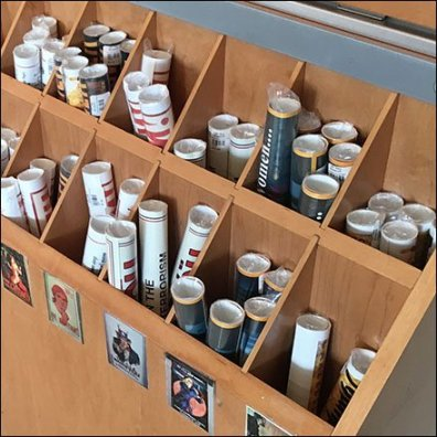Wall of Wood Poster Bins At Spy Museum
