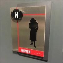 Logo Branded Fixtures - Spy Museum Restroom ID Sign In Detail