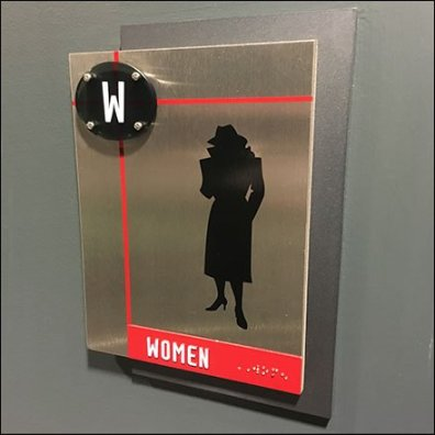 Logo Branded Fixtures - Spy Museum Restroom ID Sign In Detail
