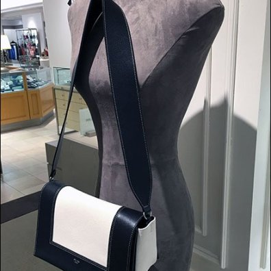 Saks Mannequin Hosts Purse Faceout