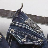 Denim Jeans 90º Tip Hook On A Bar
