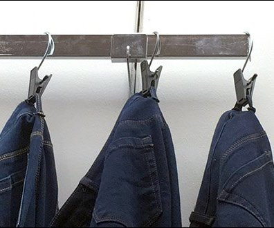 Denim Jeans Clothes Clipped On A Bar