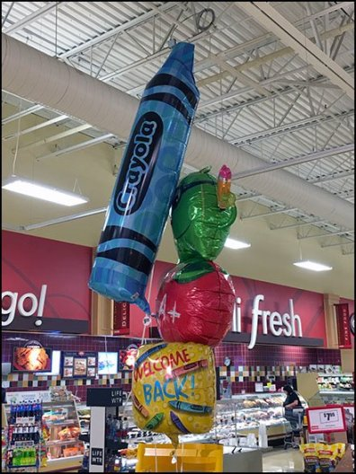 Crayola Inflatable Points To Center Store