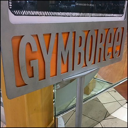 Gymboree Branding In Silhouetted Stainless Steel