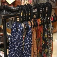 Iron Pipe Scarf Bar Merchandising Feature
