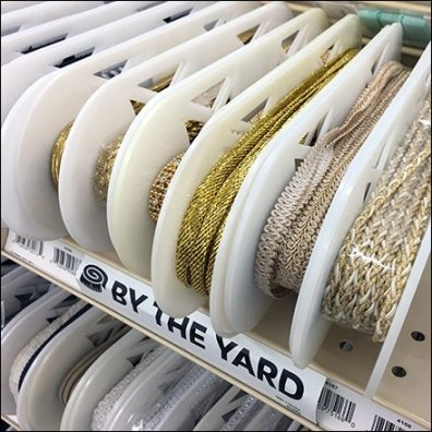 Elliptical Spool Ribbon Shelf Merchandising Feature