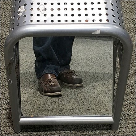 Ground Level Merchandising / Low Level Fixtures - Perforated Bench Offers Ground-Level View of Shoes