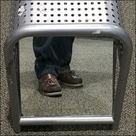 Perforated Bench Offers Ground-Level View of Shoes