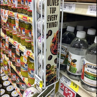 Olives Gravity Feed At The Shelf Edge