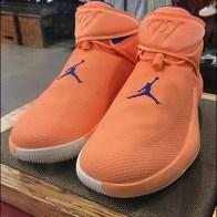 Pedestal Museum Case Promotes Nike Orange