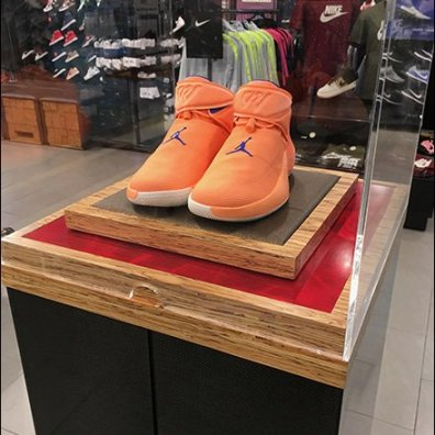 Pedestal Museum Case Promotes Nike Orange