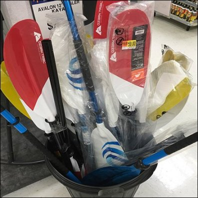 Kayak Paddle Merchandising Via Trash Can