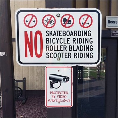 No Skateboards, Bicycles, Roller Blades or Scooters