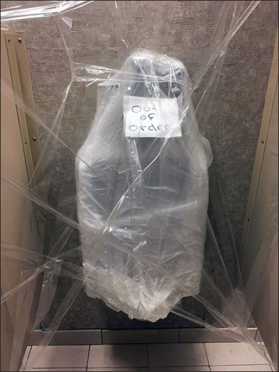 Shrink-Wrapped Out-Of-Order Urinal