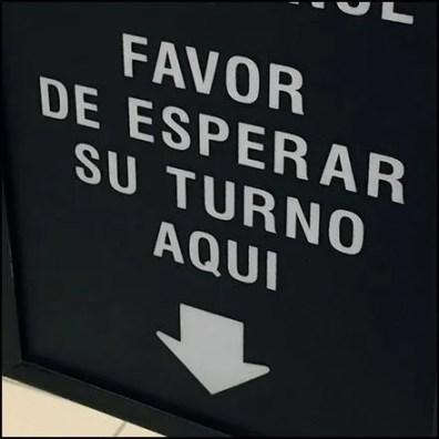 Please Wait Here Multilingual Queue Management Sign