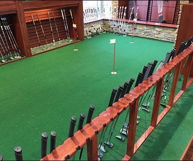 Indoor Golf Putting Green Hosts Foursome