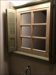 Rustic Restroom Mirror Outfitting Includes Shutters