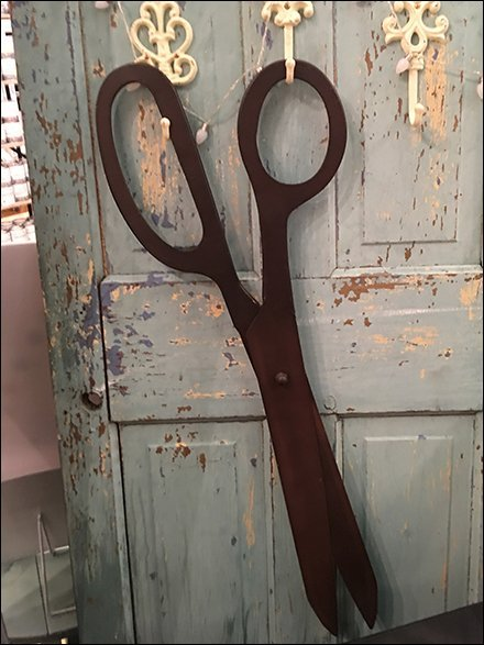 Giant Scissors Prop Cuts Through Clutter