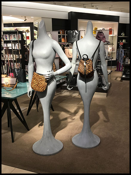 Statuesque Purse Display Coming-and-Going