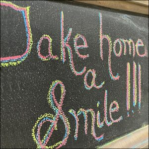 Take-Home-A-Smile Floral Chalkboard Invitation