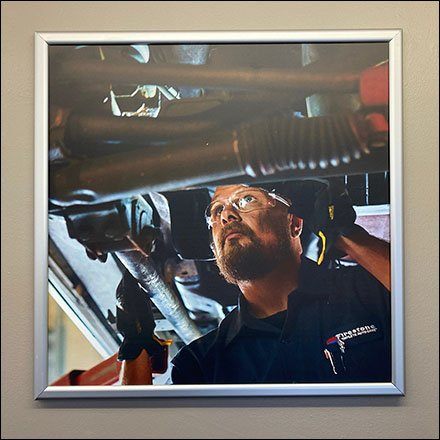 Firestone Complete Auto Care Displays andFixtures - In-Store Branding Auto Mechanic Imagery