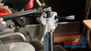 78 torque center bolt to tube