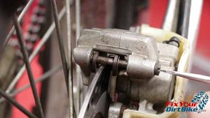 1997 - 2001 Honda CR250 - Brakes - Remove Pad Pin Plug