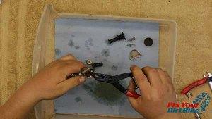 Remove Spring Clip And Pushrod