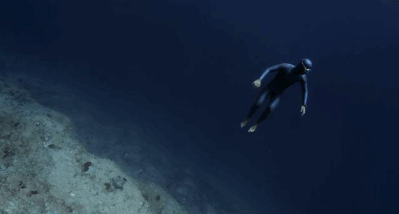 Freediver Riding an Underwater Ocean Current - Video