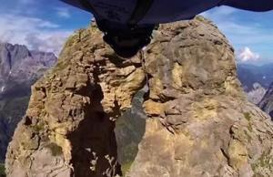Wingsuit Flight Through 2 Meter Cave