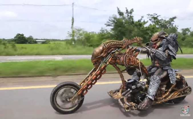 Rider Dressed as Predator Rides a Custom Alien Xenomorph Motorcycle