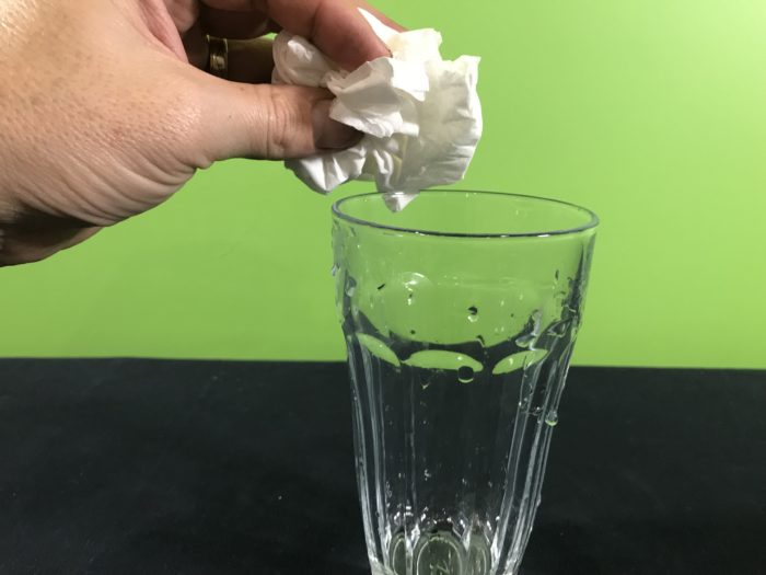 Air takes up space science experiment - adding tissue paper to an empty glass