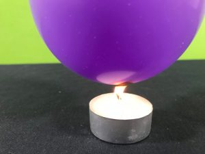 Balloon survives the flame science experiment - balloon touching the candle flame