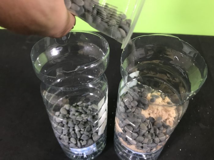 Create a water filter science experiment - adding gravel to a filter