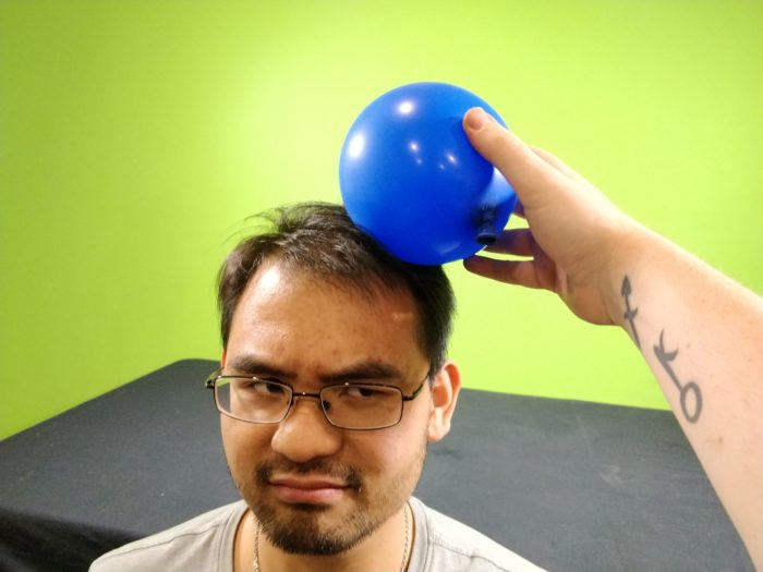 The Soda Can Attractor - rub the balloon vigorously on your volunteer_s head