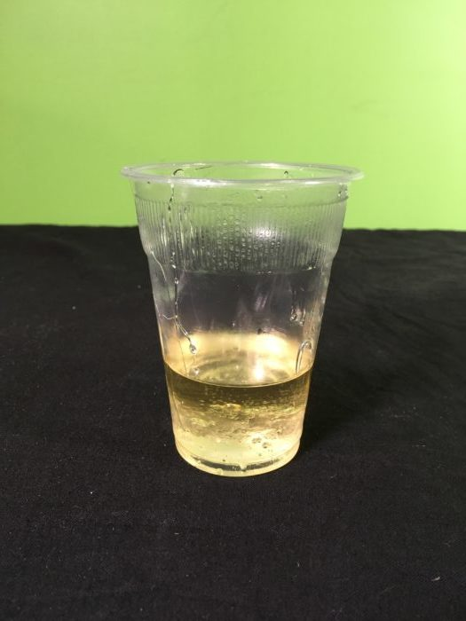 Making Layered Liquids Science experiment - adding vegetable oil