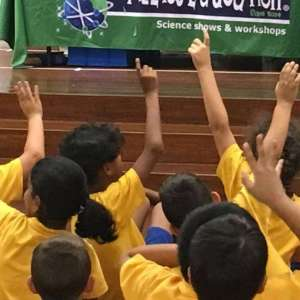 Students with hands up