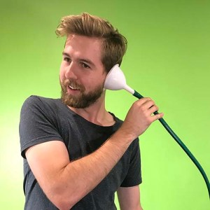 A person holding a funnel and hose to his ear
