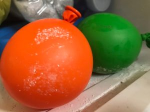 Why is an iceberg frozen and not water below science experiment - balloons in the freezer