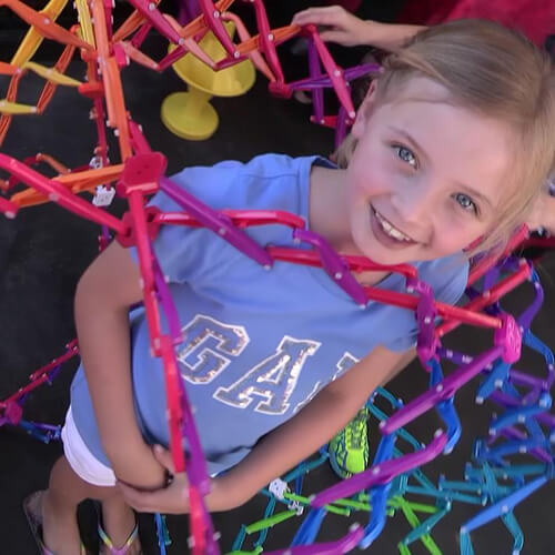 Child in hoberman sphere during a kids science party