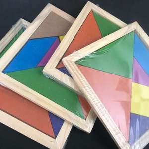 Set of 4 tangram puzzles piled on top of each other
