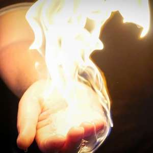 hand with flame around it without injury