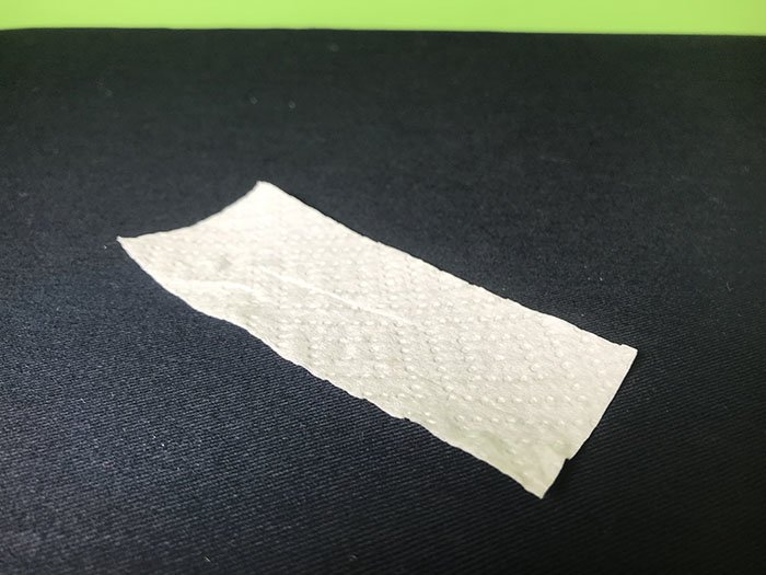 A strip of white paper on a black table cloth