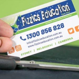 A business card an pair of scissors