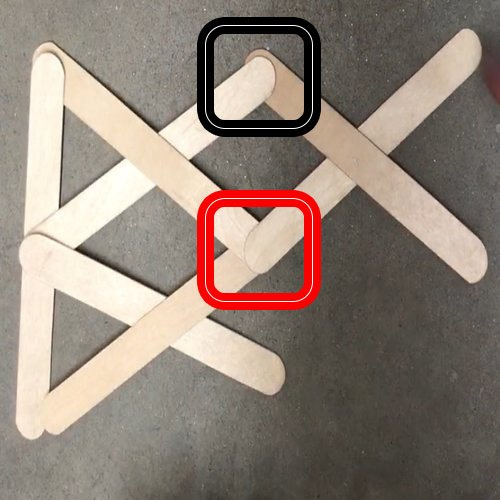 lattice of 7 wooden sticks with two squares overlayed over the image, highlighting how to connect to of the jiins in the centre of the image