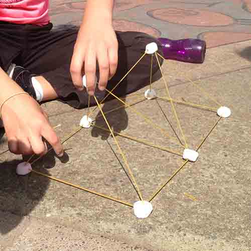 Two marshmallow pyramids joined together on the ground