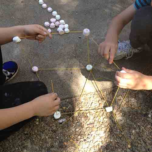 Forming a cube shaped marshmallow tower