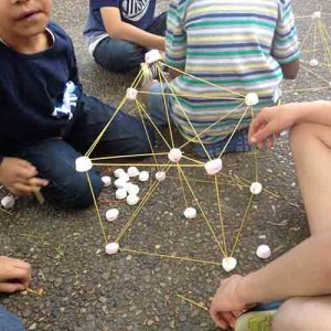 Spaghetti and marshmallow tower on the ground in the shape of a cube