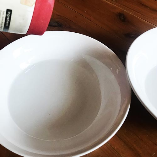 Pouring salt into a bowl of water